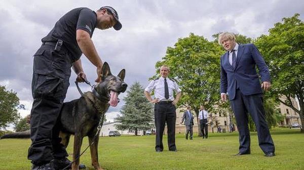 boris johnson assures scotland police chief of funding for cop 26