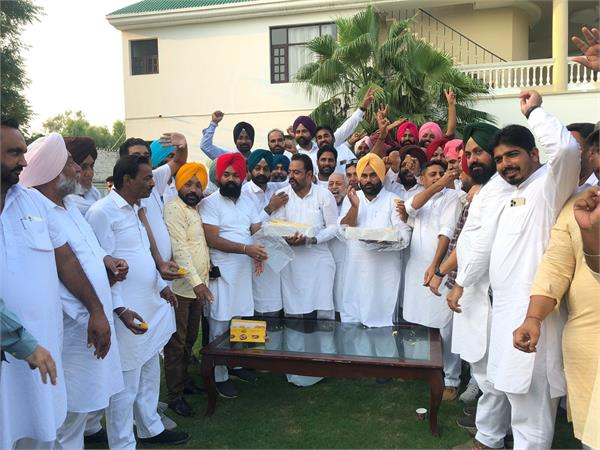 raja waring  s house workers celebrate